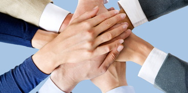 Many hands together, symbolising team work