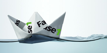 Paper boat with the logo of Fase 1